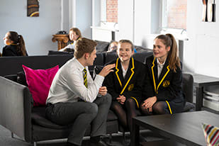 oratory pupils talking inside the boarding house